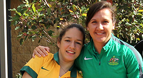 Matildas captain Lisa De Vanna with student Bella.