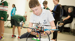 A students works on a drone.