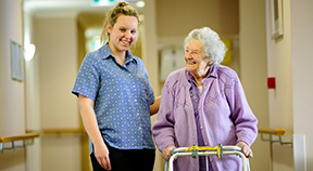 2014 School-based Apprentice of the Year Caitlin Maher with a Willowmeade resident.