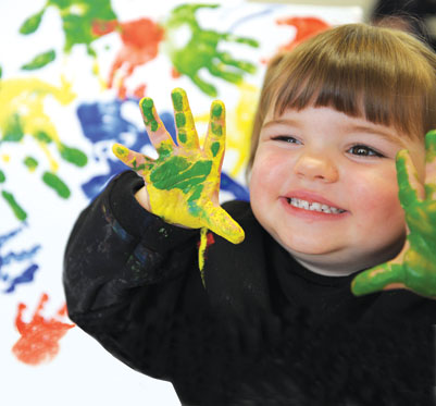 Child finger painting.