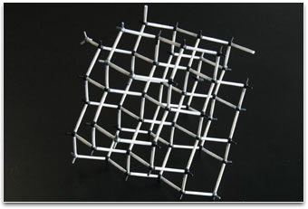 A lattice structure constructed of atoms and bonds.